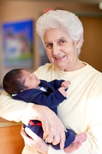 Co-founder Sister Rosita holds a child at La Esperanza.